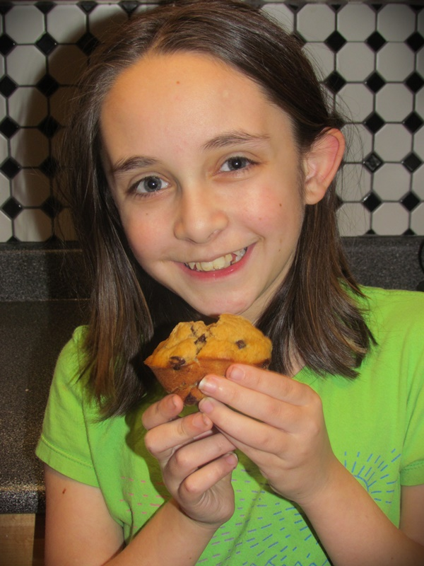 daughter and banana chocolate chip muffin