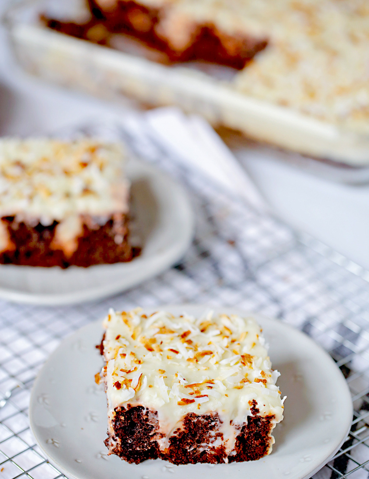 chocolate coconut poke cake slice with toasted coconut