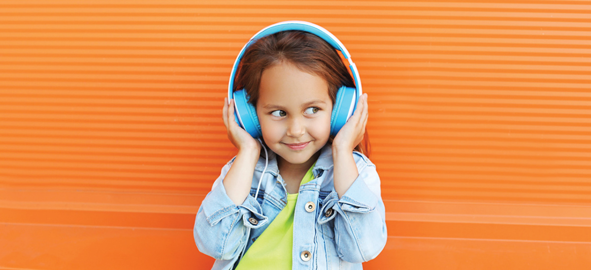 young girl with blue headphones