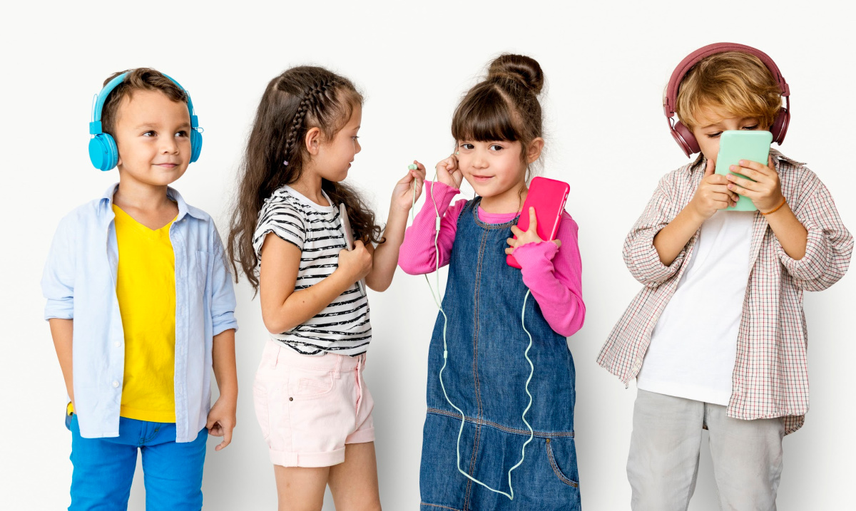 social emotional learning - group of children with headphones and phones listening to podcast