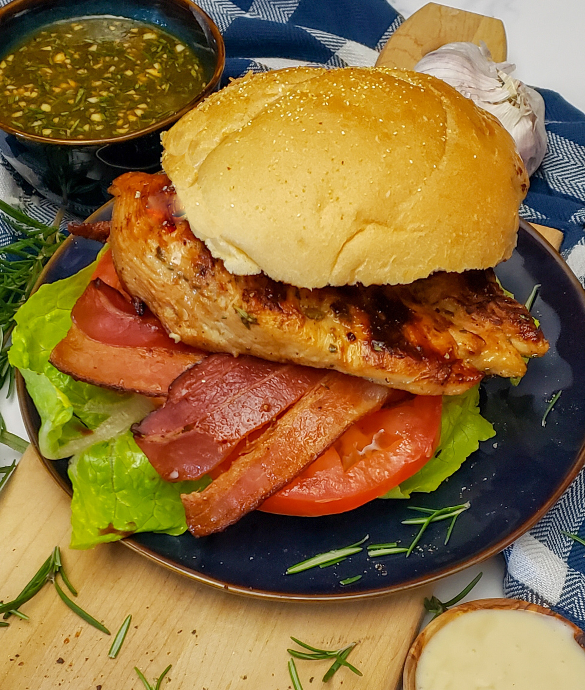 Maple Rosemary & Garlic Herb Grilled Chicken burger with bacon