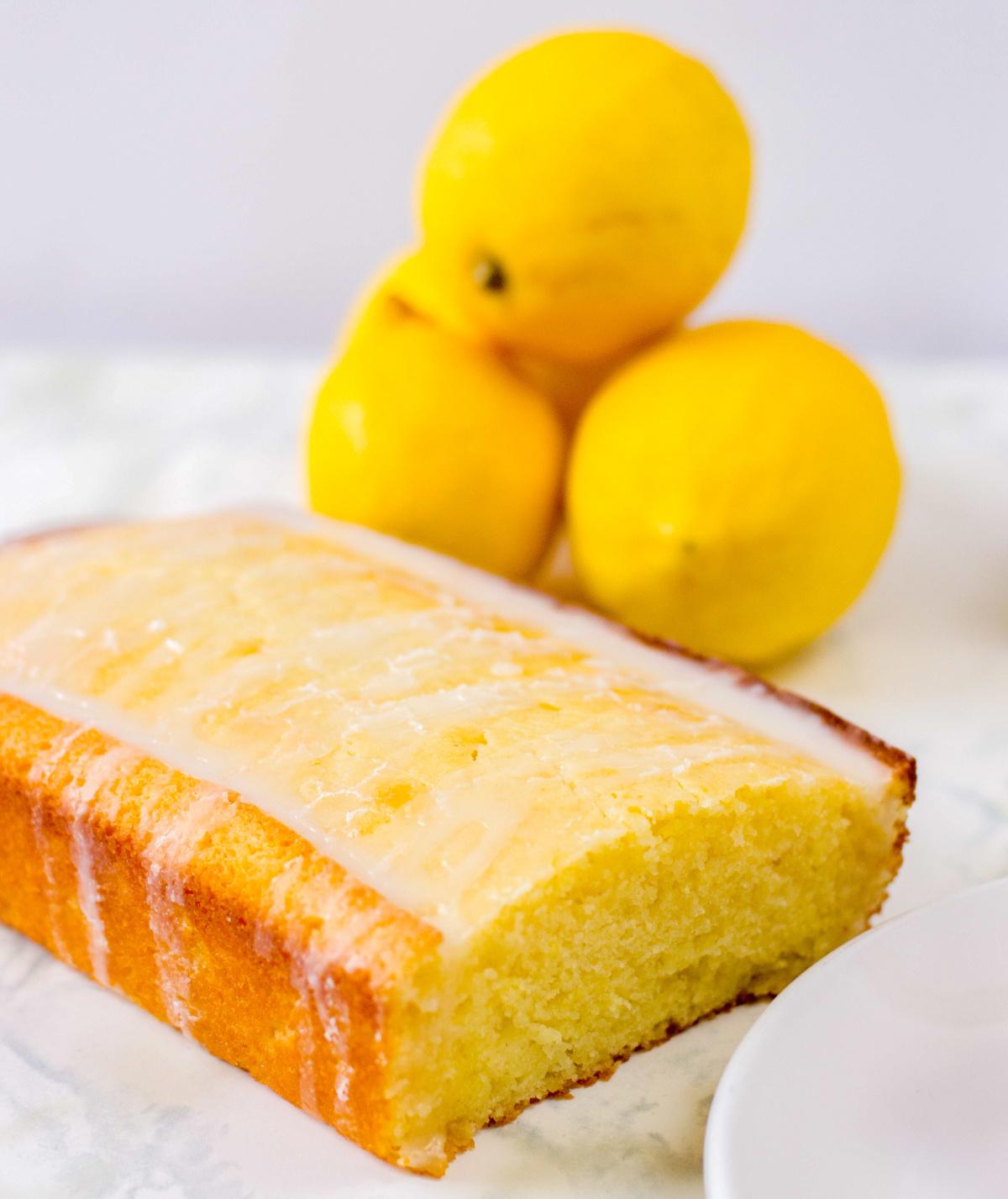 lemon loaf with lemons in the background