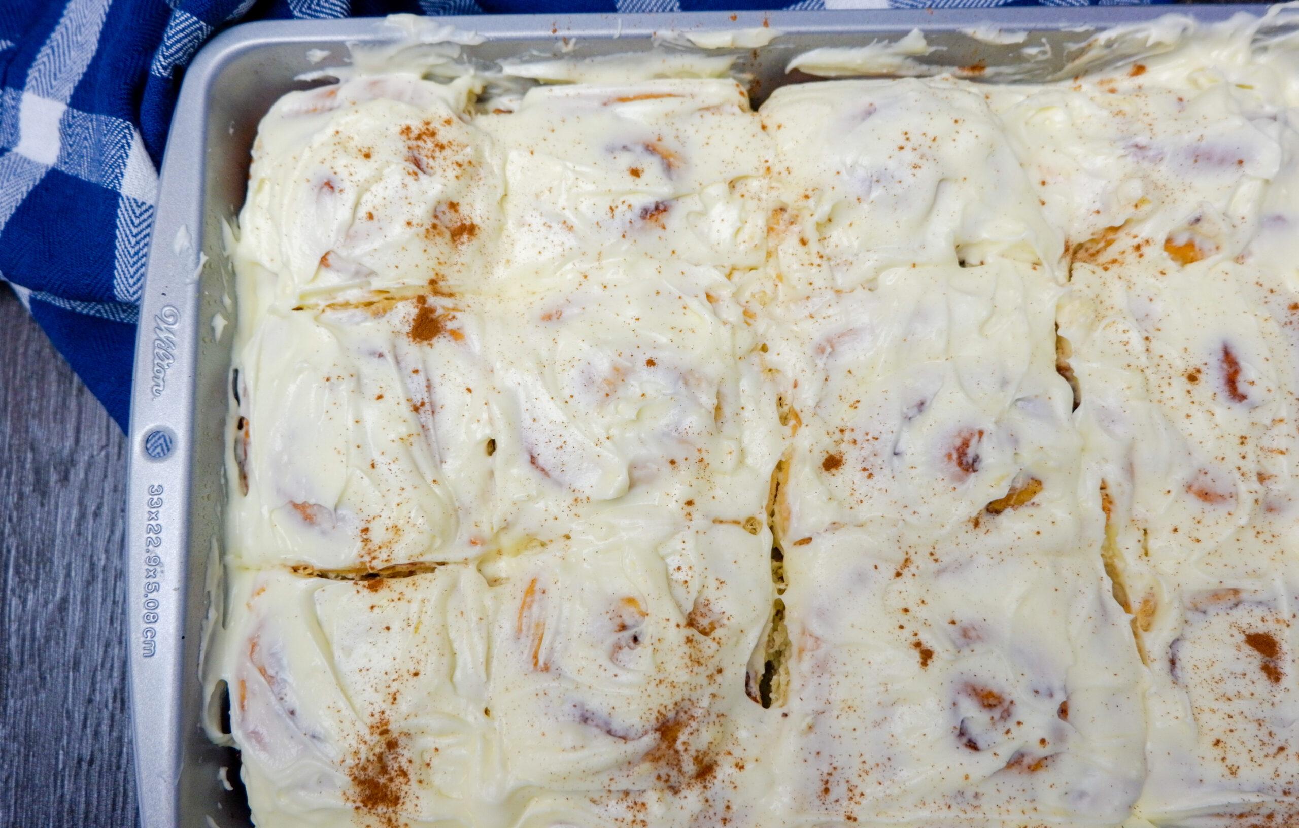 cream cheese cinnamon roll in baking pan