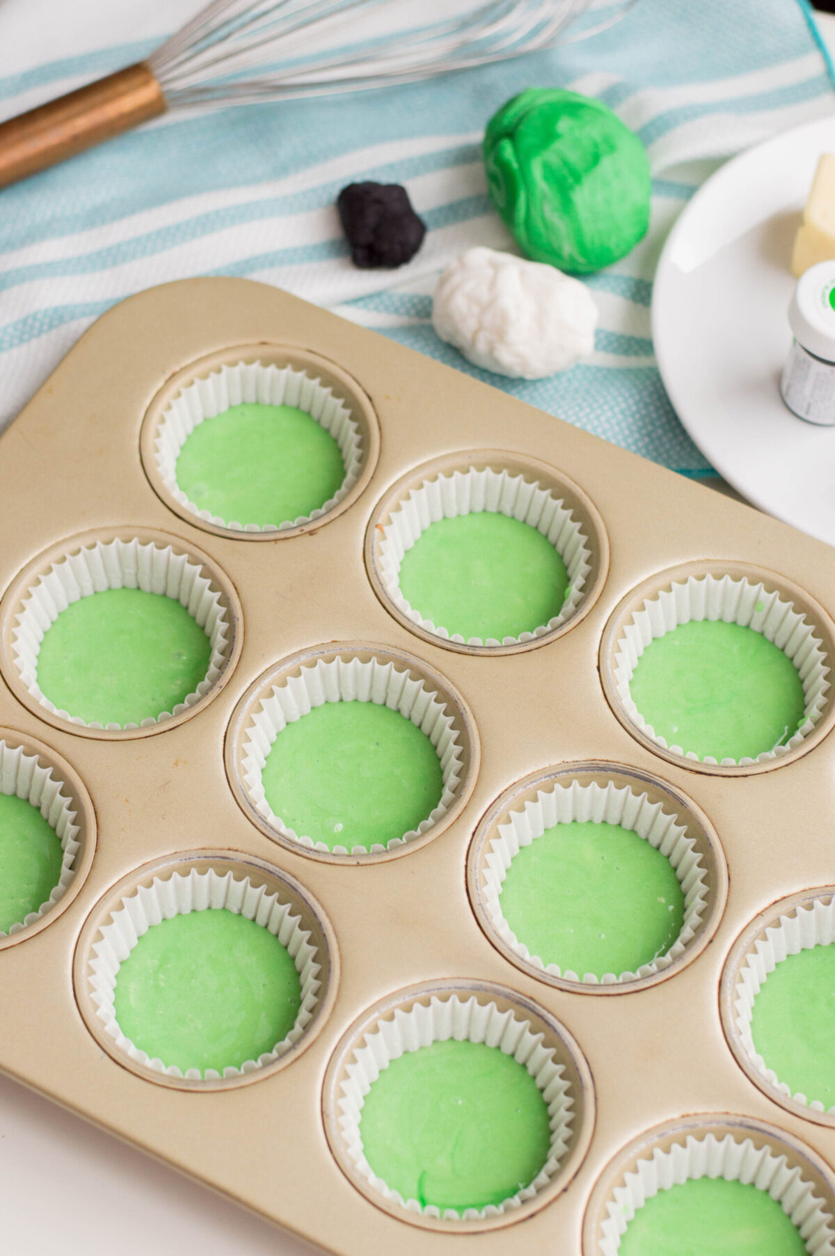 muffin tin with cupcake mix