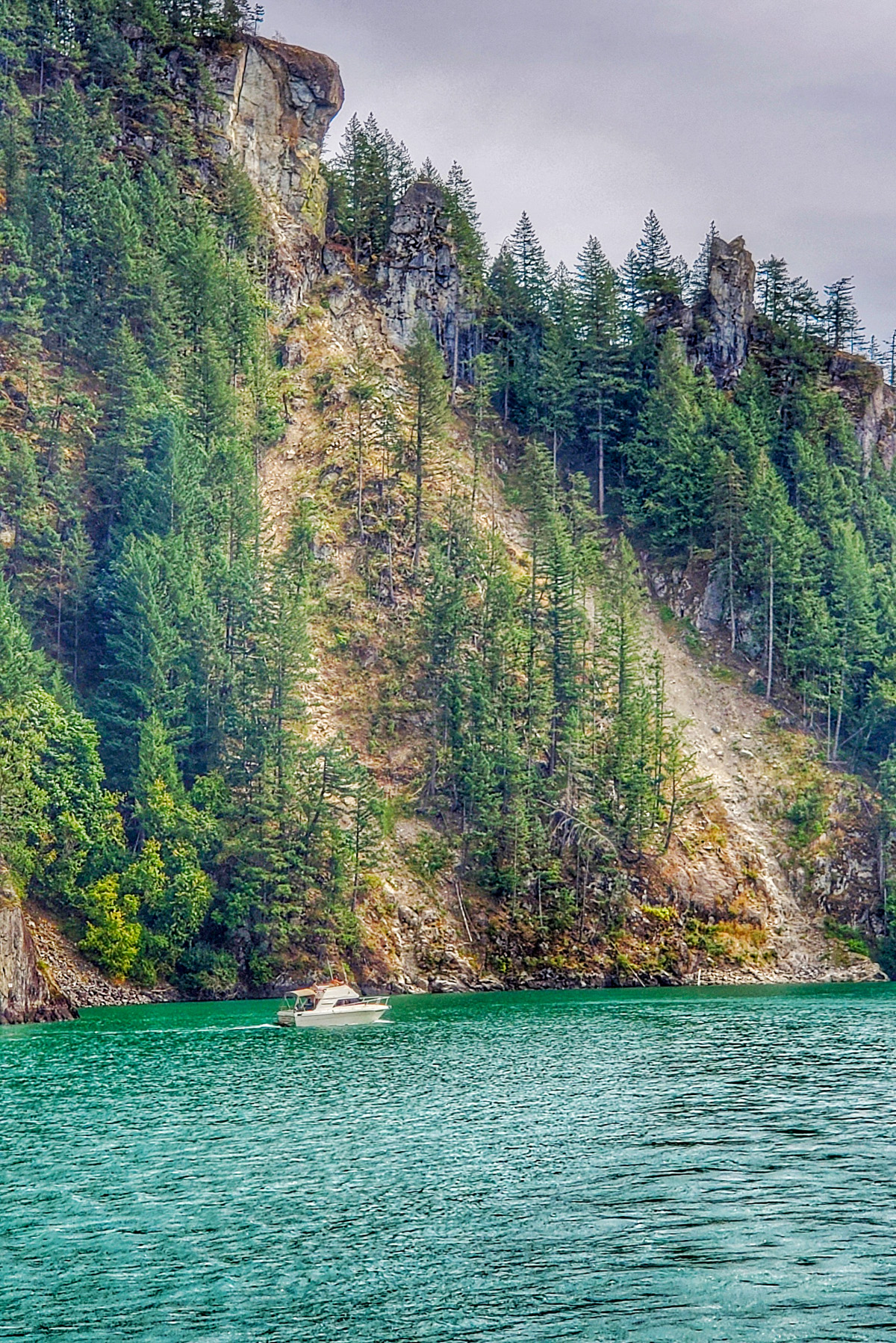 Harrison lake view with cliff and boat