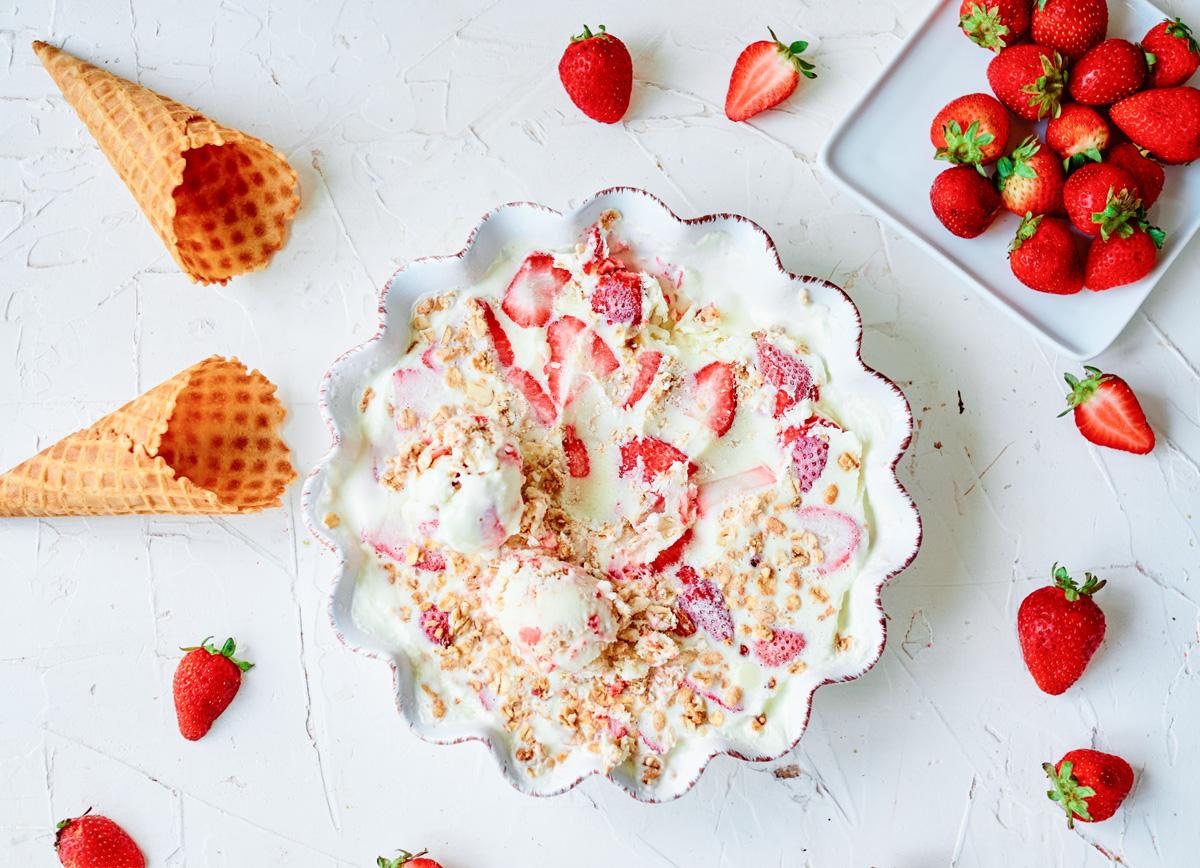 no-churn ice cream with strawberries and empty ice cream cones