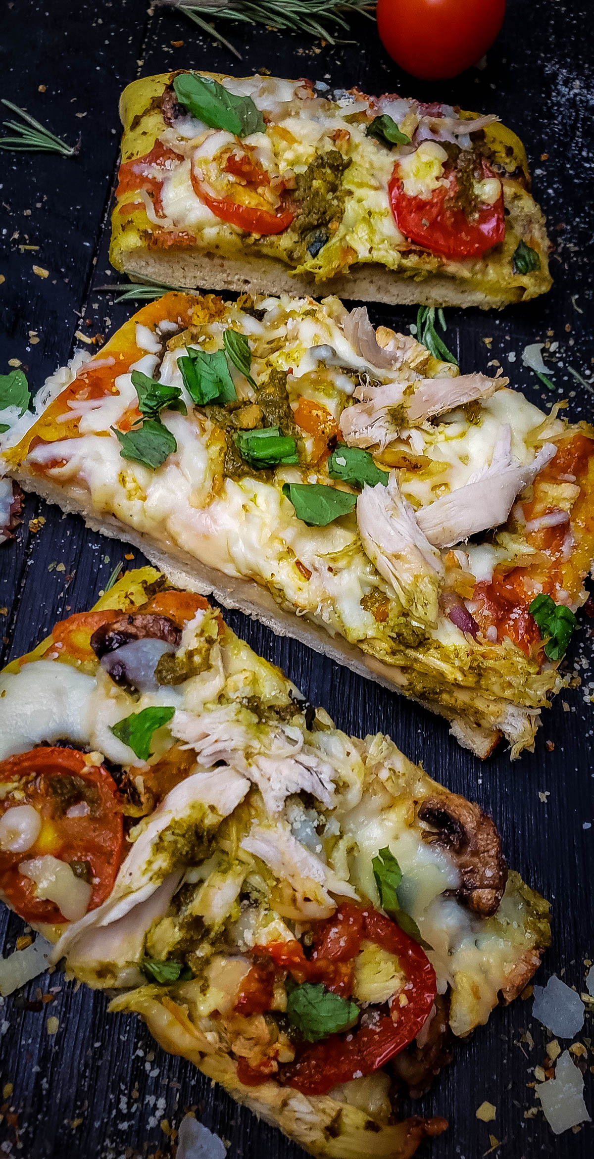 Pesto chicken pizza with different toppings