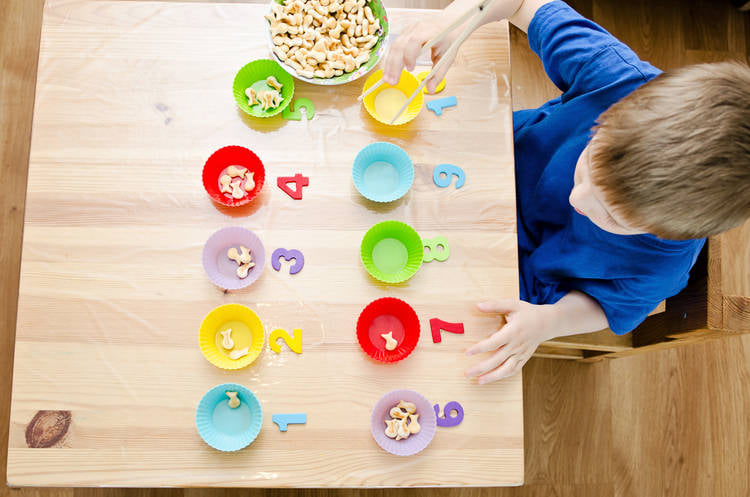 learning through play with cereal and bowls
