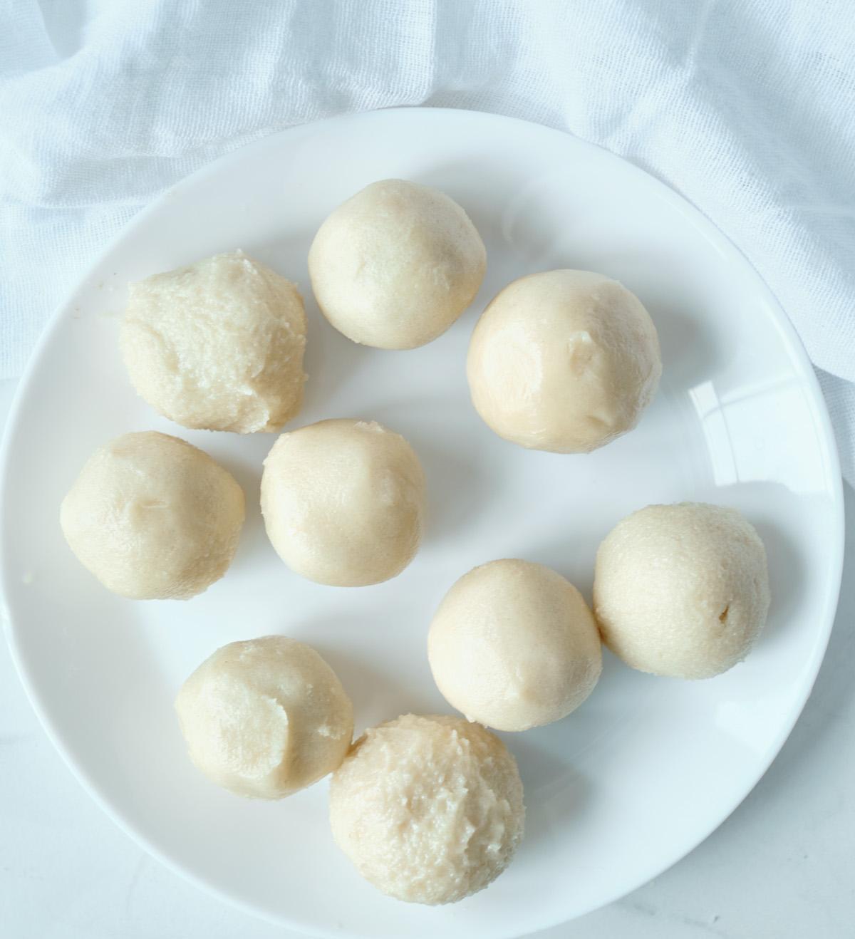 sugar cookie dough balls with caramel eggs inside