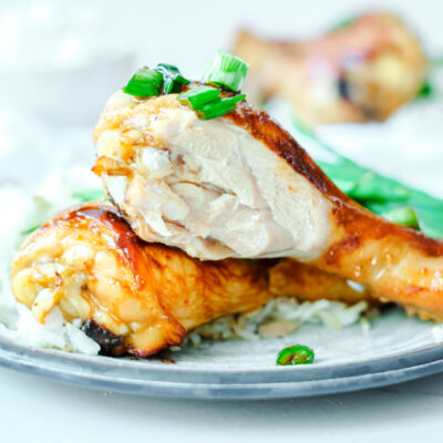 soy sauce chicken drumsticks, cut, on a plate