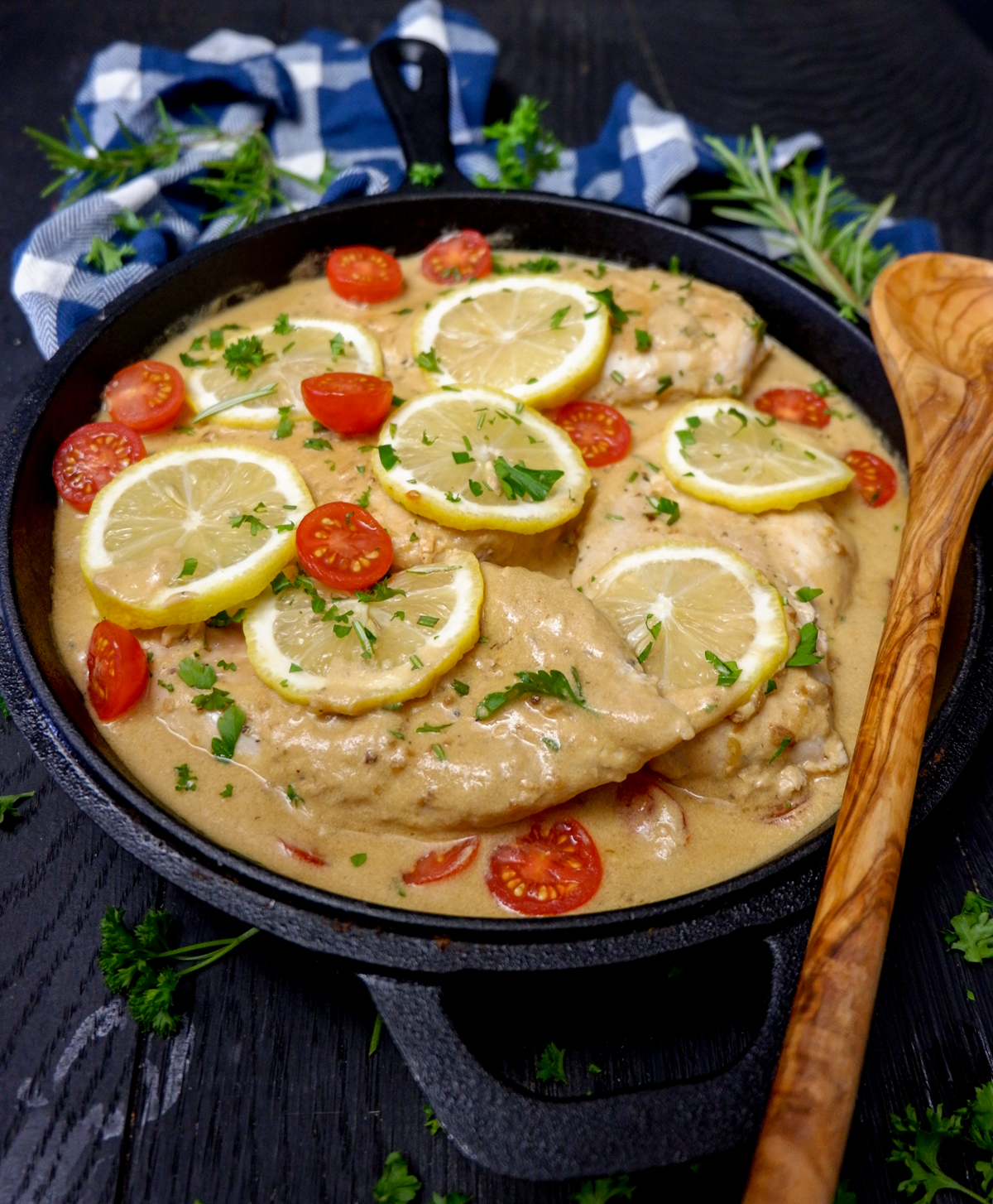 Cast Iron Skillet Creamy Lemon Chicken is the perfect weeknight meal! A simple cream sauce, garlic, fresh rosemary and other herbs for a delicious flavour.