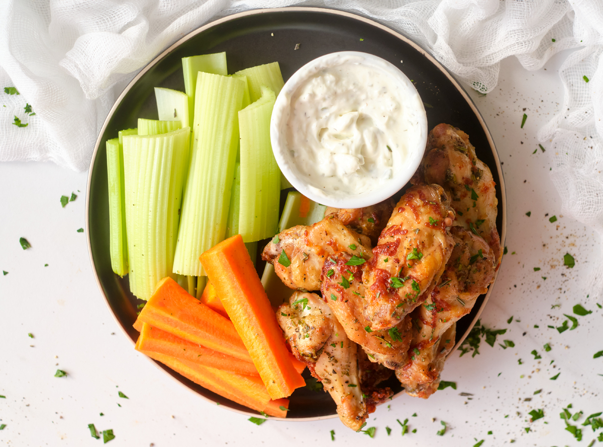 chicken wings with carrot and celery sticks and dip