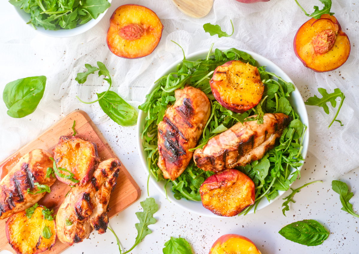 grilled balsamic chicken and peaches on arugula