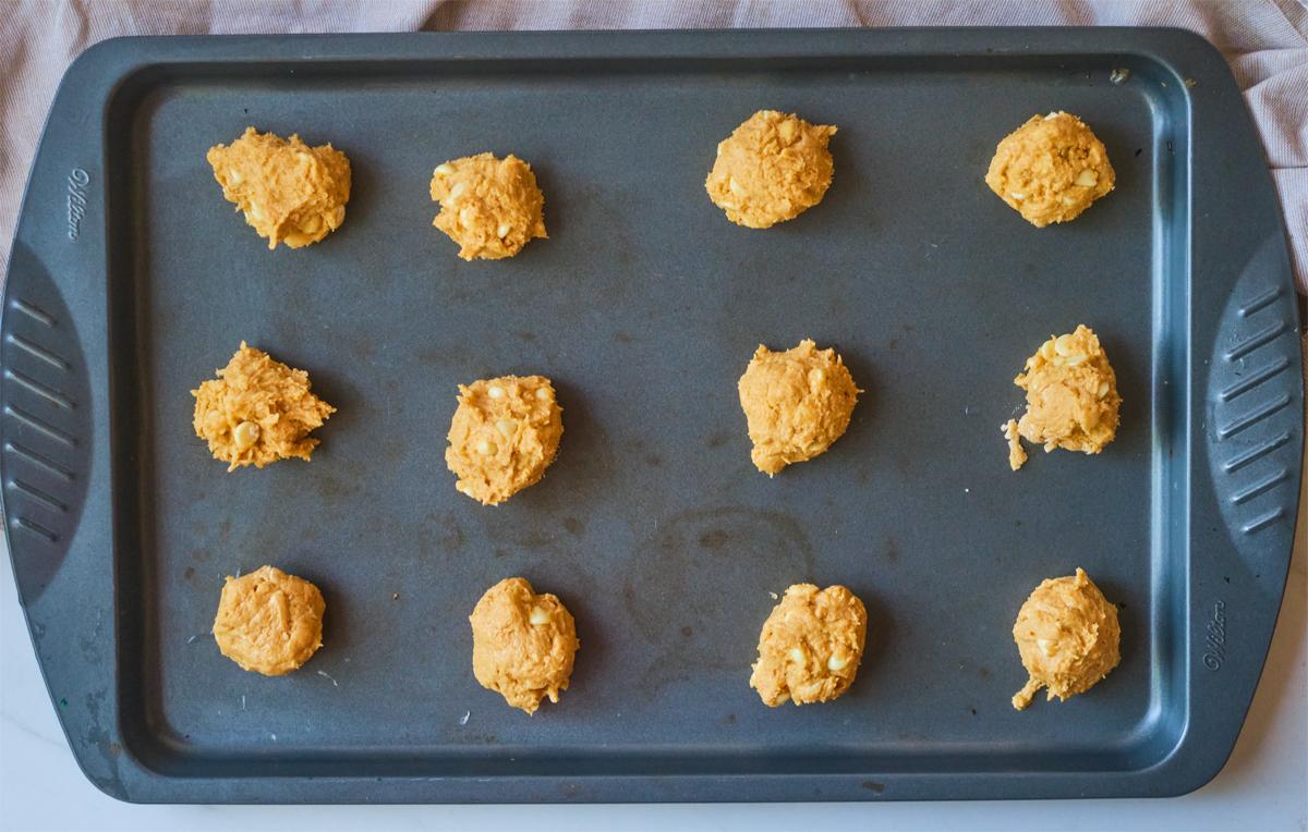 Pumpkin White Chocolate Chip Cookies - dough on a cookie sheet